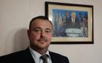 Sergej Kravchenko in seinem Büro mit Putin-Bild an der Wand. Der Unternehmer kämpft um einen Listenplatz der Partei «Einiges Russland»
