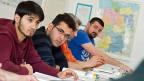 Syrische Flüchtlinge beim Deutschunterricht in einem Integrationskurs in Hannover.
