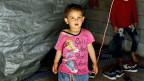 Ein syrisches Flüchtlingskind vor einer Unterkunft in der Türkei.