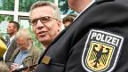 Deutschlands Innenminister Thomas de Maizière besucht am 10. August eine Inspektion der Bundespolizei in Bremen.