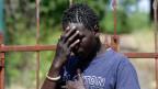 Ein junger Mann aus Gambia in deinem Aufnahmezentrum in Sizilien. Viele seiner Landsleute haben das Ziel, in der Schweiz Asyl zu erhalten.
