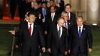 Der chinesische Präsident Xi Jinping führt die Staatschefs zur nächsten Sitzung am G20-Gipfel..