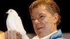 Kolumbiens Präsident Juan Manuel Santos erhält den Preis für seine Bemühungen, den Krieg in seinem Land zu beenden.
