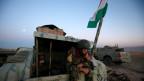 Ein Peshmerga-Kämpfer im Osten von Mosul während der Operation auf den Angriff auf IS-Extremisten.