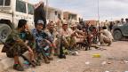 Angehörige der libyschen Miliz vor einem Einsatz gegen den IS in Sirte.