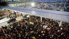 Am Flughafen JFK demonstrierten am Wochenende viele Menschen gegen die neue Einreisepolitik von Donald Trump.