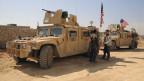 Syrische Rebellen und US-amerikanische Truppen koordinieren ihr Vorgehen in Syrien.
