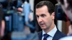 Präsident Bashar Assad spricht mit Journalisten in Damaskus, Syrien.