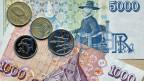 Die isländische Währung Krone. Isländische Frauen erhalten durchschnittlich 15% weniger Lohn als Männer.