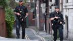 Polizei-Patrouille in Manchester. Beim Anschlag auf ein Pop-Konzert sterben 23 Personen.