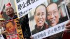 Foto des eingesperrten chinesischen Friedensnobelpreisträgers Liu Xiaobo während eines Protestes für seine Freilassung in Hongkong.