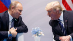 Präsident Donald Trump (rechts) trifft Russlands Präsident Vladimir Putin am G20-Gipfel in Hamburg.