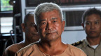 Der Senior Berater der Royal Thai Army Lt. Gen. Manas Kongpaen kommt vor das Strafgericht in Bangkok, Thailand.