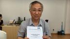 Chef-Übersetzer Cai Mingjiong.
