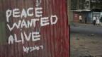 Graffiti an einer Wand in Nairobi nach den Wahlen in Kenya.