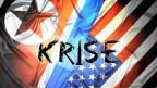 Der UN-Sicherheitsrat hat den neuerlichen Test einer Mittelstreckenrakete durch Nordkorea in einer Sondersitzung einstimmig als «empörend» verurteilt. Symbolbild: Fahnen von den USA und Nordkorea mit dem Schriftzug «Krise»..