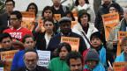 Migranten demonstrieren gegen Trump.