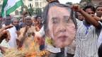 Rohingya protestieren gegen Aung San Suu Kyi.