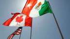 Die Flaggen der USA, Kanada und Mexiko.