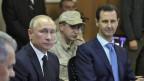 Der russische Präsident Wladimir Putin und der syrische Präsident Baschar al-Assad auf dem Hmeymim-Stützpunkt in Syrien 11. Dezember 2017.