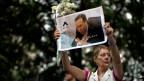 Eine Frau mit dem Bild des toten Staatsanwalts Alberto Nisman am 28. Januar 2015.