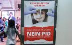 Ein Plakat der Gegner der PID, vor der Eidgenössischen Volksabstimmung am 14. Juni 2015.