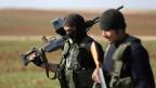 Kurdische Kämpfer in der Nähe der syrischen Stadt Aleppo.