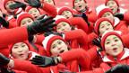 Weibliche Fans aus Nordkorea sorgten für Aufmerksamkeit an den olympischen Spielen.