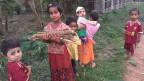 Kinder in einem Dorf in Burma.