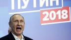 Der Kopf Putins, er lacht siegesbewusst.
