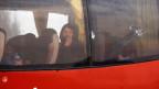 Mit Bussen werden syrische Rebellen und ihre Angehörigen aus Ostghouta in den Norden des Landes deportiert.