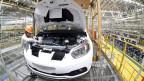 China öffnet Wirtschaftszweige, z.B. die Herstellung von Elektroautos.