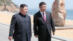 Kim Jong-un, Nordkoreanischer Diktatot (links) und Xi Jinping, Chinas Präsident.