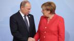 Wladimir Putin und Angela Merkel.