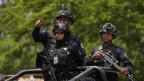 Schwer bewaffnete Polizisten in Mexiko.