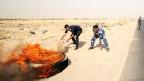 Die Proteste begannen mit brennenden Reifen und Sitzstreiks in der Hafenstadt Basra, mitten in der Sommerhitze.