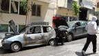Vor einer Polizeiwache im Athener Stadtteil Exarcheia wurden im Mai 2011 mehrere Autos in Brand gesteckt. Was ist ihnen von den Protesten damals hängengeblieben?