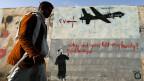 Wand-Graffiti in Sanaa, das US-Drohnen im Jemen anklagt.