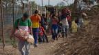 Venezolaner überqueren illegal die Grenze zu Kolumbien.