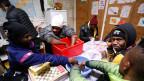 Flüchtlinge, welche in Briancon/Frankreich eingetroffen sind.