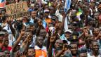 Anhänger des Oppositionskandidaten an einer Kundgebung in der Demokratischen Republik Kongo. Die für den 23. Dezember angekündigten Wahlen wurden um zwei Jahre verschoben, was zu Protesten und mehreren hundert Toten geführt hatte.