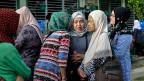 Frauen vor dem Abstimmungslokal in Mindanao. Die Bürgerinnen und Bürger können darüber abstimmen, ob sie die neue autonome muslimische Region Bangsamoro erschaffen wollen.