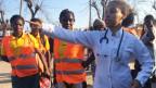 Ärztinnen fordern die Bewohner im Flüchtlingscamp auf, sich bei Beschwerden sofort zu melden.