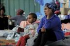 Migranten in Libyen, die vor den Kämpfen geflüchtet sind