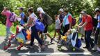 Migranten aus Mittelamerika auf dem Weg Richtung USA auf einer Autobahn, in Ciudad Hidalgo, Mexiko, 5. Juni 2019.