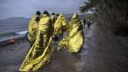 Migranten nach ihrer Ankunft. Symbolbild.