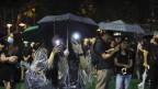 Protestierende im Regen