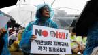 Eine Frau protestiert gegen die Sanktionen an einer Anti-Japan-Demonstration in Seoul, Südkorea.