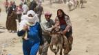 Viele Menschen sind auf der Flucht von Syrien nach Irak.