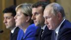 Zelenskiy, Merkel, Macron und Putin (von links nach rechts) bei der Pressekonferenz im Elysee Palast.
